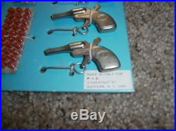 Vintage Complete Miniature Tiny Mite Cap Gun Store Display with 12 guns 12 caps