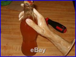 Whistle Soda Cast Iron Hand with Vintage Orange Bottle